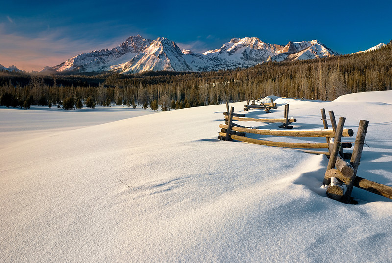 Sawtooths sunrise and pole fence