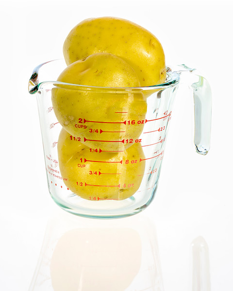 Measuring Cup with Potatoes