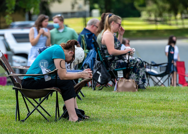 Shannon Skevakis bows her head in prayer following Communion at the 11 am outdoor Mass June 28, 2020 on the grounds of St. Mary Magdalen Mission in Bel Air. (Kevin J. Parks/CR Staff)