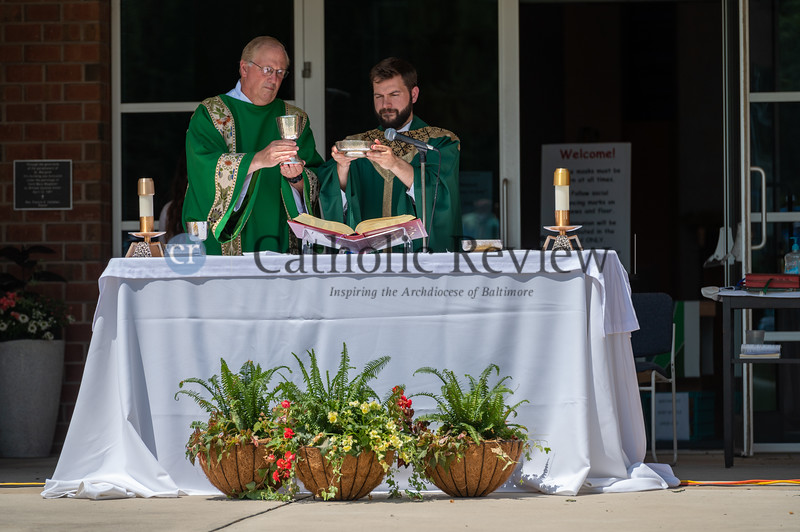 Deacon Bruce Hultquist, left, and Father Matthew DeFusco celebrate 11 am outdoor Mass June 28, 2020 on the grounds of St. Mary Magdalen Mission in Bel Air. Some 300 parishioners were in attendance. (Kevin J. Parks/CR Staff)