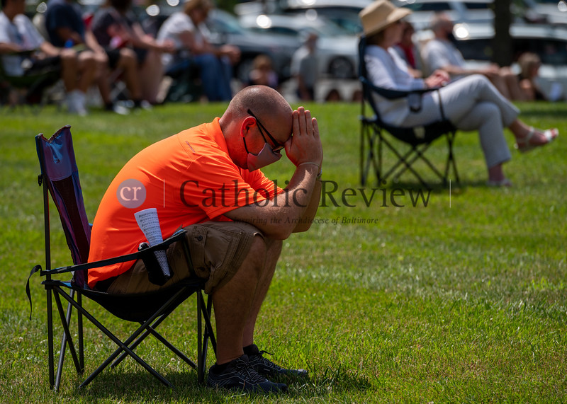 Larry Jehnert prays following Communion at the 11 am outdoor Mass June 28, 2020 on the grounds of St. Mary Magdalen Mission in Bel Air. (Kevin J. Parks/CR Staff)