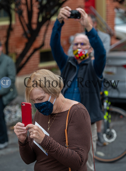 Members of the Catholic Community of South Baltimore gather outside St. Mary, Star of the Sea Church on Riverside Ave. in South Baltimore Oct. 20 for the reinstallation of the parish's steeple cross damaged by storms last spring. (Kevin J. Parks/CR Staff)