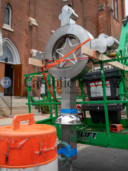 The St. Mary, Star of the Sea Church steeple cross waits for reinstallation Oct. 20 in South Baltimore. Storms last spring left the neighborhood icon dangling requiring repairs. (Kevin J. Parks/CR Staff)