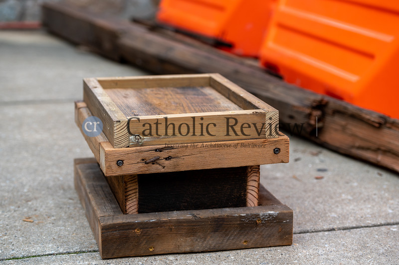 A parish time capsule constructed of wood from the church steeple damaged during storms last April sits on the curb outside St. Mary, Star of the Sea Church in South Baltimore Oct. 20. (Kevin J. Parks/CR Staff)