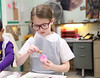 HOLLY PELCZYNSKI - BENNINGTON BANNER Natalie Pello, second grader at St. Mary's Academy paints easter eggs at the Hoosick Falls Senior Center on Tuesday morning in Hoosick Falls NY.