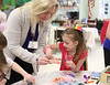 HOLLY PELCZYNSKI - BENNINGTON BANNER Peyton Meyers 8 years old of Hoosick Falls decorates some easter egg crafts on Tuesday morning with Kelly Slingerland of the Center for Nursing and Rehabilitation at the Hoosick Falls Senior Center in Hoosick Falls NY