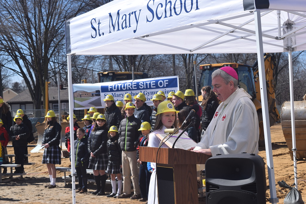 . Detroit Bishop Robert Fisher addresses the crowd of community leaders, church parishioners, teachers and 409 students in attendance for Friday\'s ground-breaking ceremony for St. Mary\'s School gymnasium.