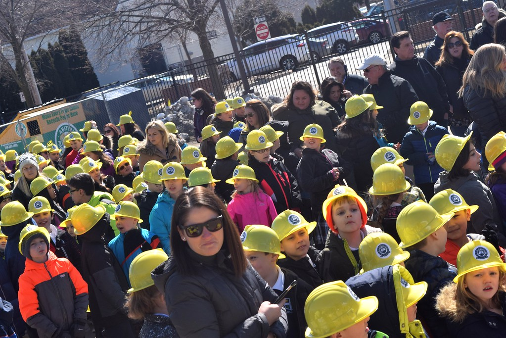 . Meredith Francis, front and center, stands with her students during Friday\'s ground-breaking ceremony for the new gymnasium. Francis\' said all of the children are excited about the new gym including her own children.