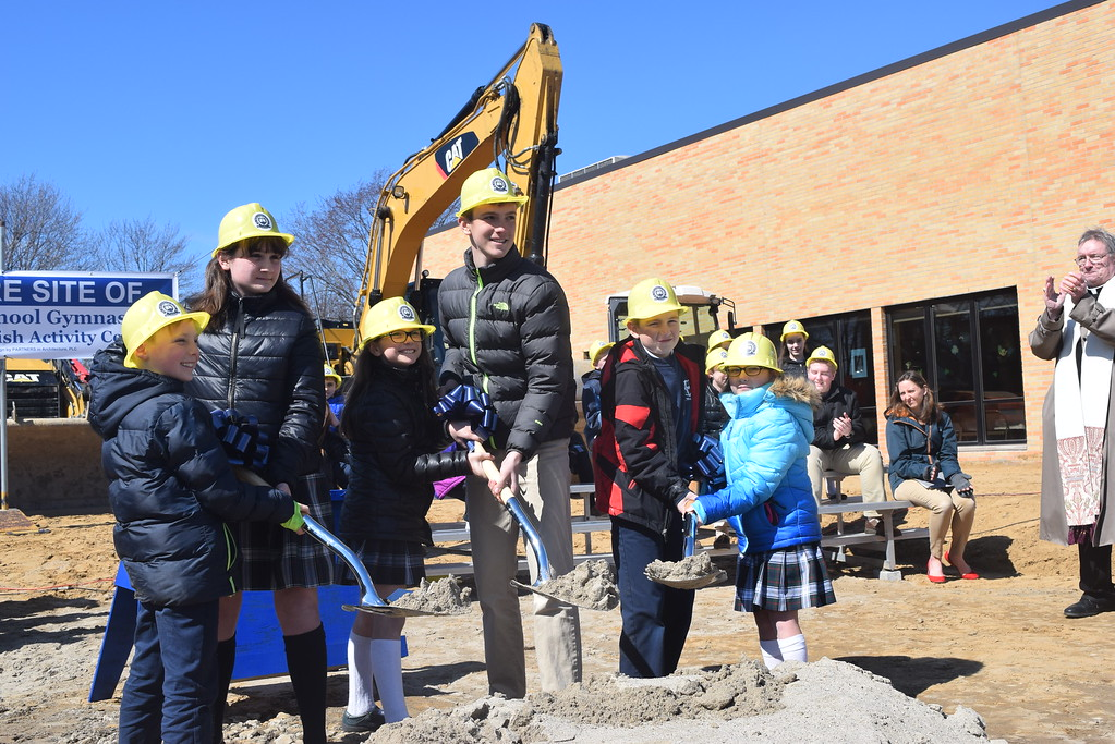 . Six students representing their classmates were given the honor of raising shovels of dirt during the official ground-breaking ceremony for St. Mary\'s Catholic School gymnasium in Mount Clemens.