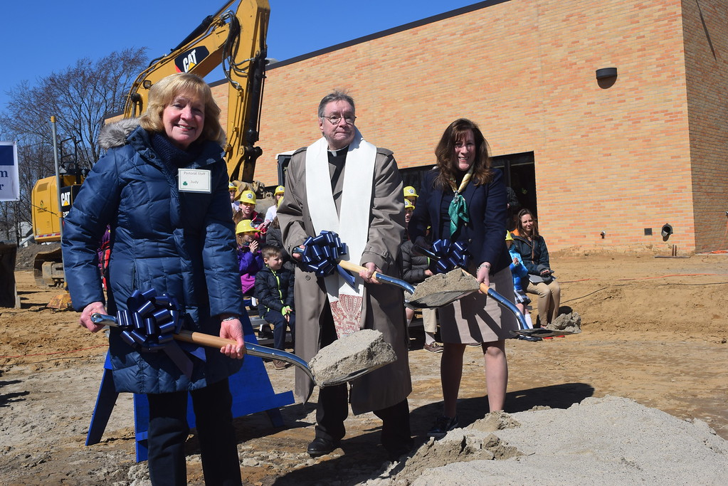 . Raising their shovels during the official ground-breaking ceremony for St. Mary\'s Catholic School gymnasium are principal Maureen  Miscavish, far  right, Fr. Michael Clooney and Judy Coll.