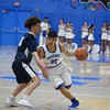 Silver's Tristin Moore, number 10, covers St. Mike's Jevon Montoya, number 20, during the first quarter of the St. Michael's High School vs Silver High School boys basketball game at St. Mike's on Friday, January 11, 2019. Luis Sánchez Saturno/The New Mexican