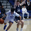Slivers' Steven Cross, number 30, covers St. Mike's Victor Otero, number 13, during the first quarter of the St. Michael's High School vs Silver High School boys basketball game at St. Mike's on Friday, January 11, 2019. Luis Sánchez Saturno/The New Mexican