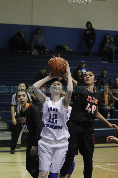 Taos' Madeline Quintana, number 40, blocks a shot from St. Mike's Jodi Gormley, number 12, during the first quarter of the St. Michael's High School vs Taos High School girls basketball game at St. Mike's on Monday, February 19, 2018. Luis Sánchez Saturno/The New Mexican