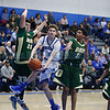 St. Mike's Devon Flores, number 34, looks for the open man as he is double teamed by West Las Vegas' John Balizan, number 20, and D.J. Byron, number 12, during the first quarter of the St. Michael's High School vs West Las Vegas High School at St. Mike's on Wednesday, February 6, 2019. Luis Sánchez Saturno/The New Mexican