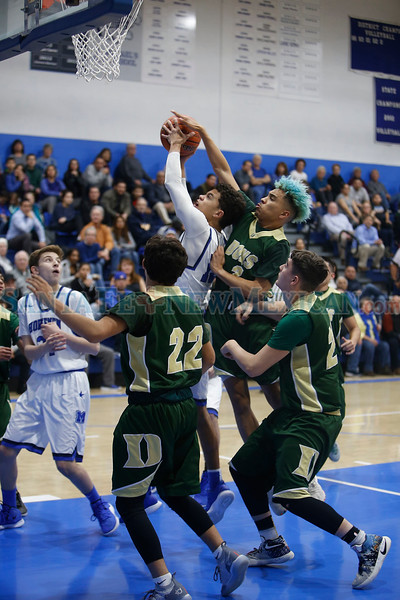 West Las Vegas' Isaiah Paiz, number 2, tries to block a shot from St. Mike's Hayden Lee, number 10, during the first quarter of the St. Michael's High School vs West Las Vegas High School at St. Mike's on Wednesday, February 6, 2019. Luis Sánchez Saturno/The New Mexican