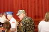 Representatives of Ukrainian American Veterans enter the auditorium.<br />  Вхід представників Організації Українсько-Американських ветеранів до святкової зали.