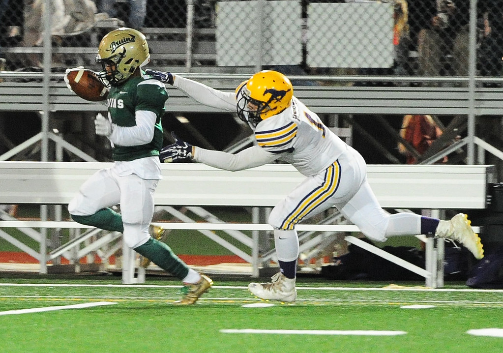 . MARTINEZ, CA- DEC. 2, St. Patrick-St. Vincent\'s Kailon Johnson-loud runs for a big gain after a catch before he is brought down by Middletown\'s  Logan Tacla during the Bruin\'s 28-0 win on Saturday. (CHRIS RILEY/Times-Herald)