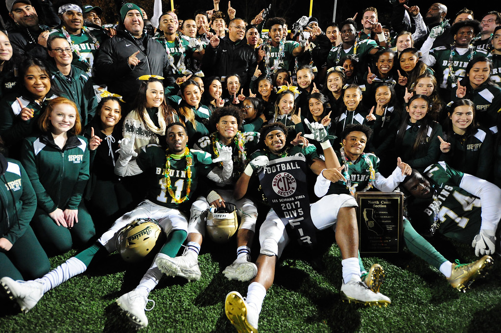 . MARTINEZ, CA- DEC. 2, St. Patrick-St. Vincent High School celebrates the Bruin\'s 28-0 win over Middletown in the North Coast Section title game on Saturday. (CHRIS RILEY/Times-Herald)