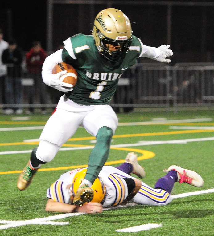. MARTINEZ, CA- DEC. 2, St. Patrick-St. Vincent\'s Kailon Johnson-loud escapes a tackler after an interception during the Bruin\'s 28-0 win over Middletown in the North Coast Section title game on Saturday. (CHRIS RILEY/Times-Herald)