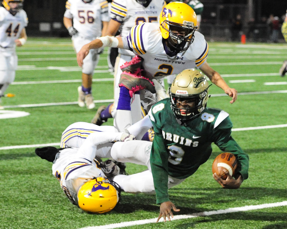 . MARTINEZ, CA- DEC. 2, St. Patrick-St. Vincent\'s Akil Edwards fights for yardage during the Bruin\'s 28-0 win over Middletown in the North Coast Section title game on Saturday. (CHRIS RILEY/Times-Herald)