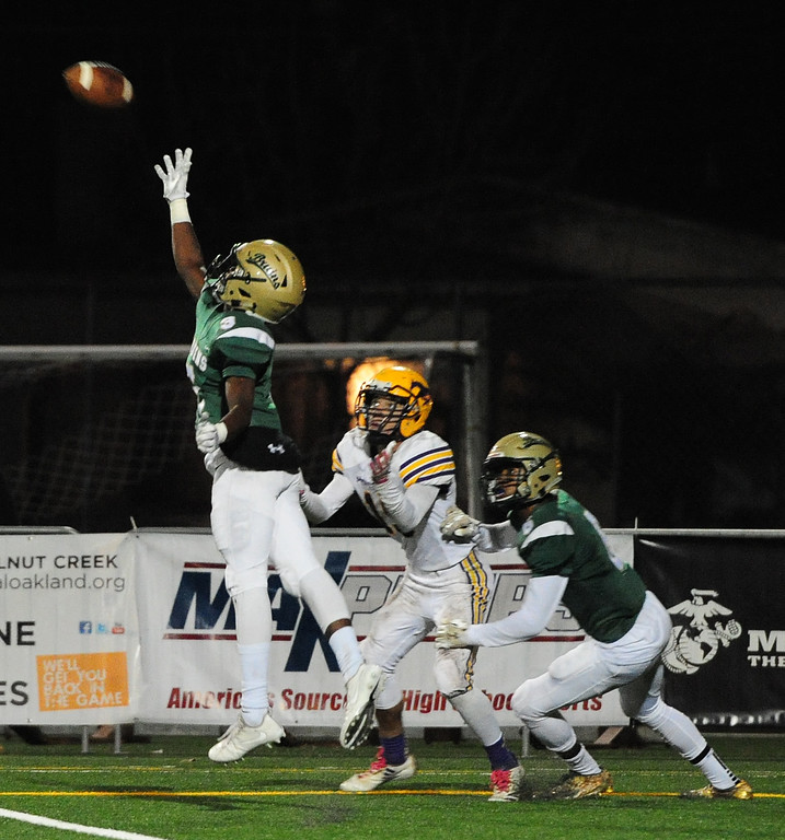 . MARTINEZ, CA- DEC. 2, St. Patrick-St. Vincent\'s Murvin Kenion tips a pass and eventually makes the interception during the Bruin\'s 28-0 win over Middletown in the North Coast Section title game on Saturday. (CHRIS RILEY/Times-Herald)