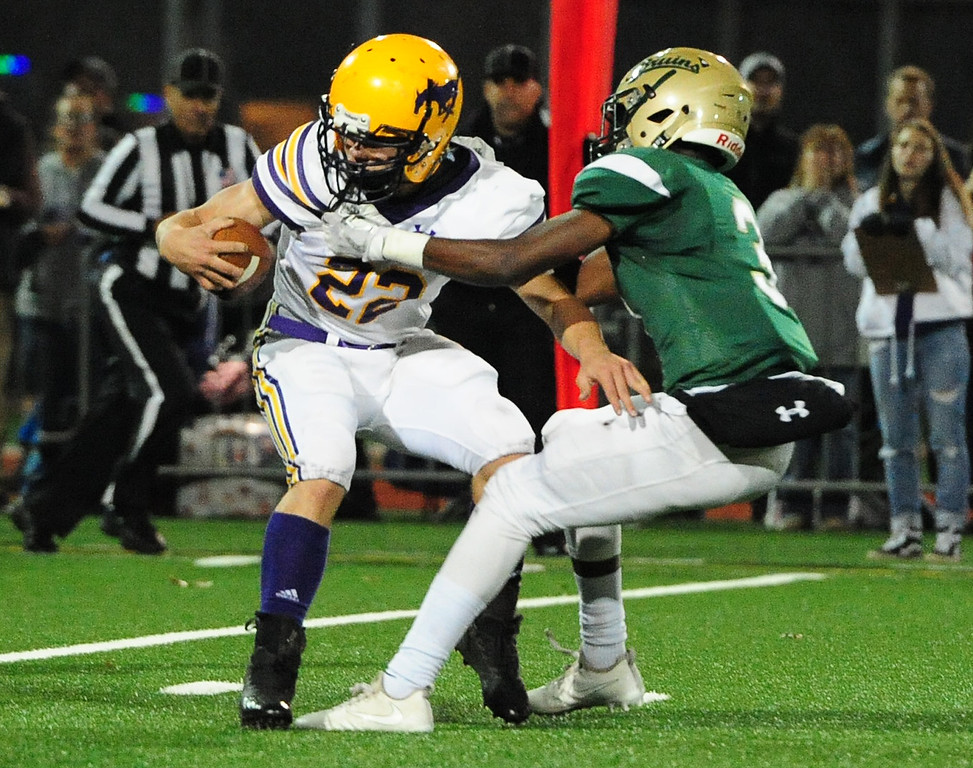 . MARTINEZ, CA- DEC. 2, St. Patrick-St. Vincent\'s Murvin Kenion takes down Middletown\'s Drake Harbison behind the line of scrimmage during the Bruin\'s 28-0 win over Middletown in the North Coast Section title game on Saturday. (CHRIS RILEY/Times-Herald)