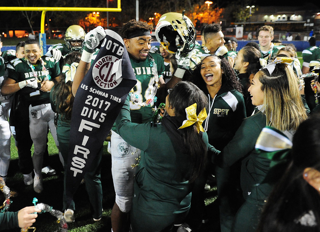 . MARTINEZ, CA- DEC. 2, St. Patrick-St. Vincent\'s Marshel Martin is congratulated by cheerleaders after the Bruins won the North Coast Section title game 28-0 over Middletown in Martinez on Saturday. (CHRIS RILEY/Times-Herald)