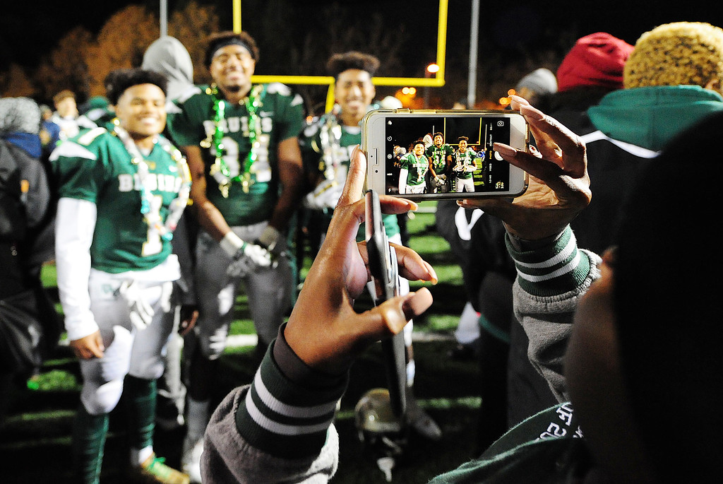 . MARTINEZ, CA- DEC. 2, St. Patrick-St. Vincent footbal players celebrate the Bruin\'s 28-0 win over Middletown in the North Coast Section title game on Saturday. (CHRIS RILEY/Times-Herald)