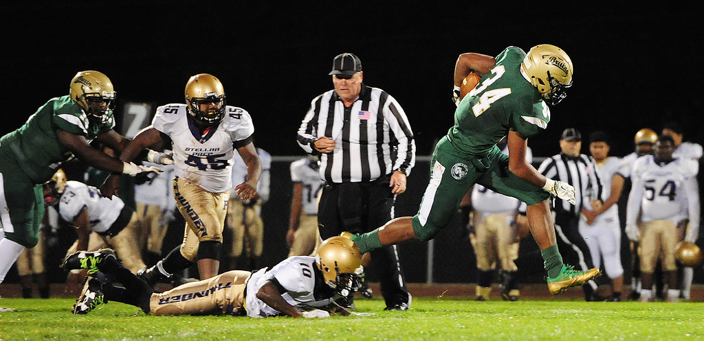 . VALLEJO, CA- NOV. 17, St. Patrick-St. Vincent\'s Marshel Martin breaks free from a Stellar Prep defender during the Bruin\'s 52-12 win over in the quarterfinals of the NCS playoffs in Vallejo on Friday. (Chris Riley/Vallejo Times-Herald)