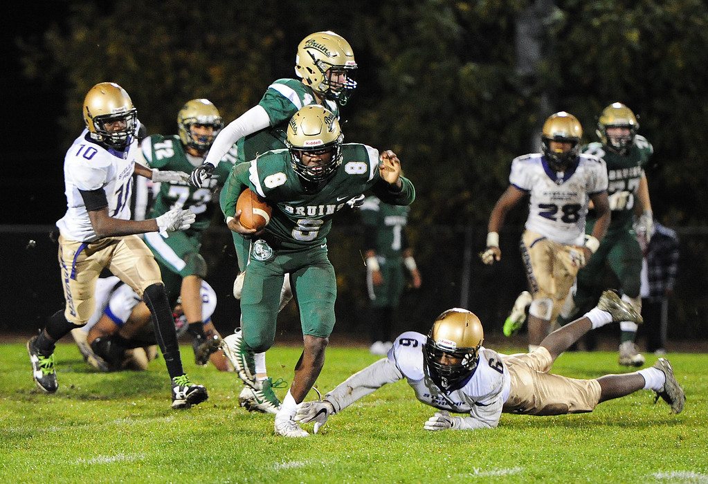 . VALLEJO, CA- NOV. 17, St. Patrick-St. Vincent\'s Akil Edwards shakes a defender to run for one of his three rushing touchdowns during Friday\'s 52-12 win over Stellar Prep in the quarterfinals of the NCS playoffs in Vallejo.  (Chris Riley/Vallejo Times-Herald)