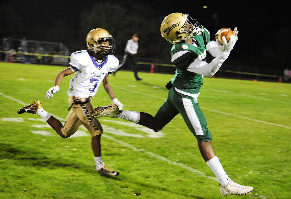 . VALLEJO, CA- NOV. 17, St. Patrick-St. Vincent\'s Murvin Kenion makes an over the shoulder catch during Friday\'s 52-12 win over Stellar Prep in the quarterfinals of the NCS playoffs in Vallejo. The play was called back for offensive pass interference. (Chris Riley/Vallejo Times-Herald)