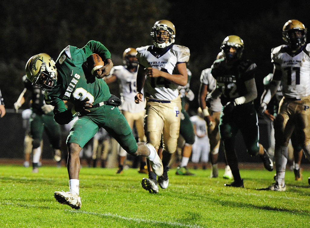 . VALLEJO, CA- NOV. 17, St. Patrick-St. Vincent\'s quarterback Akil Edwards breaks through the line on his second rushing touchdown during Friday\'s 52-12 win over Stellar Prep in the quarterfinals of the NCS playoffs in Vallejo.  (Chris Riley/Vallejo Times-Herald)