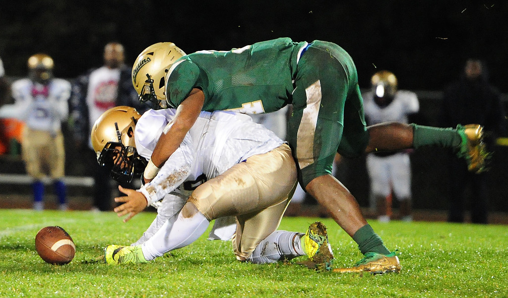 . VALLEJO, CA- NOV. 17, St. Patrick-St. Vincent\'s Marshel Martin forces Stellar Prep quarterback Dremon Williams to fumble the ball during the Bruin\'s 52-12 win over in the quarterfinals of the NCS playoffs in Vallejo on Friday. (Chris Riley/Vallejo Times-Herald)