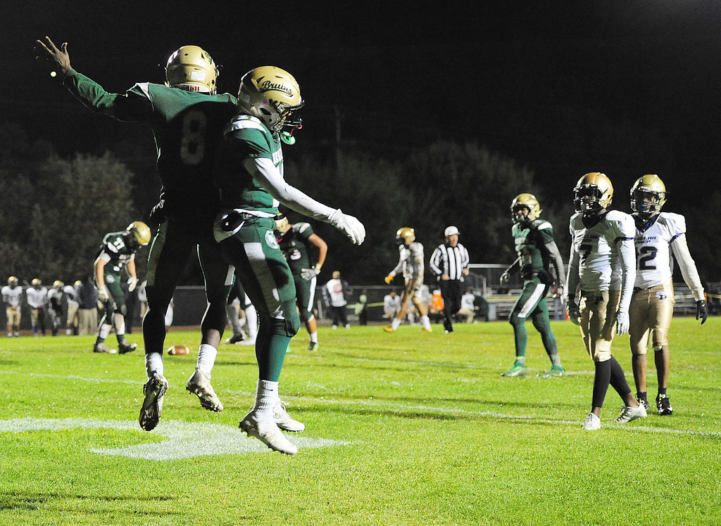 . VALLEJO, CA- NOV. 17, St. Patrick-St. Vincent\'s Akil Edwards celebrates a touchdown with Maliq Ivy during Friday\'s 52-12 win over Stellar Prep in the quarterfinals of the NCS playoffs in Vallejo.  (Chris Riley/Vallejo Times-Herald)