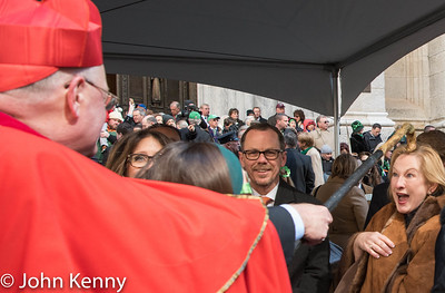 Cardinal Dolan gets the attention of a woman watching the St. Patrick's Day Parade with him, in front of St. Patrick's Cathedral.   3/17/17