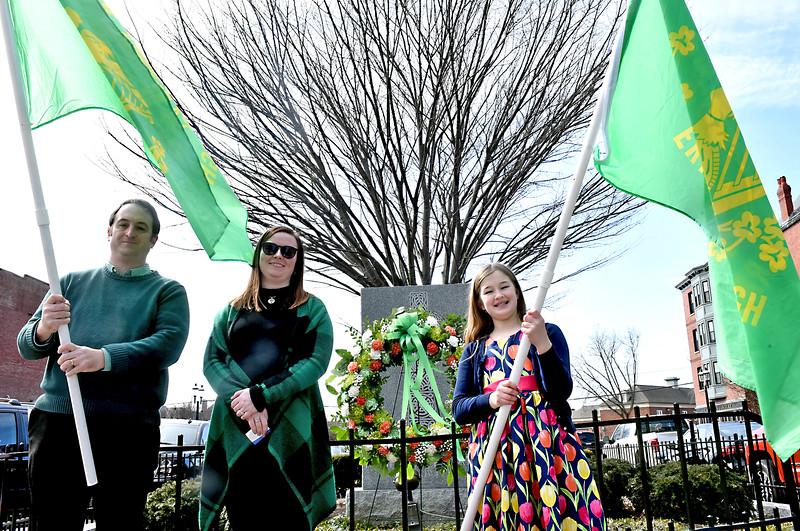 Showing their Irish spirit at the Irish American Memorial is L-R, Brian Flaherty of Dracut, Kaelagh Haley ( she laied the wreath) and Erin Flaherty 10 of Dracut., SUN/ David H. Brow