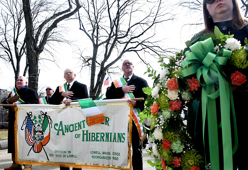 Kicking off Irish Cultural Week is Irish Flag rasing at Lowell City Hall holding banner for the Ancient Order of Hibernians is L-R, Tom Casey, John Reidy and Steve Daly, on right with the Irish Memorial wreath is Kaelagh Haley. SUN/ David H. Brow.