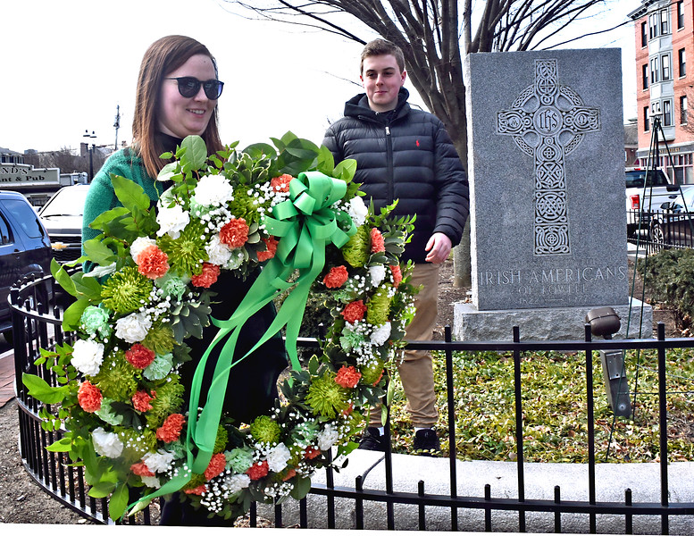 Laying of the wreath for the Irish American Memorial is Kaelagh Haley with help from Tommy Peaslee 14 of Hudson, NH. SUN/ David H. Brow.