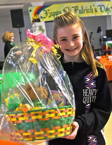 When Irish eyes are smiling as seen here with Abby Reid 10 of Lowell and a dancer for Heavey Quinn Academy of Irish Dance, after she won a raffle prize as part of the kick-off of Irish Cultural Week. SUN/ David H. Brow