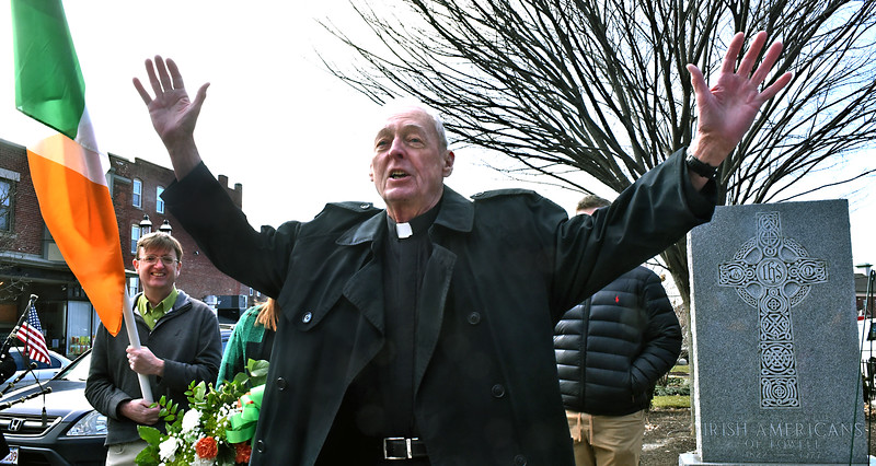 "Father ""Doc"" Conway, former pastor at St Patricks Church, gives a blessing at the Irish Americans  Veterans Memorial during the laying of the wreath. SUN/ David H. Brow"