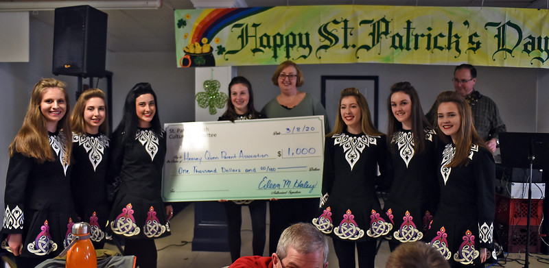 Scholarship donation from St. Patricks Irish Cultural Committee to Heavey Quinn Academy of Irish Dance, L-R, Katherine McMahon 17 of Lowell, Abby Mulhall 14 of Ashburham, Gabrielle Hughes 16 of Lowell, Ellen McMahon 13 of Lowell, Mary Heavey Quinn Academy Director, Lila Stanton 15 of Acton and she received one half of the scholarship fund., Caitlin Connorton 16 of Melrose and Alyssa O'Keefe 14 of Lynnfield. SUN/ David H. Brow