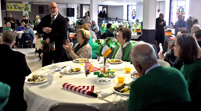 Folks enjoying a breakfast at St. Patricks Church for part of the kick-off of Irish Cultural Week. SUN/ David H. Brow