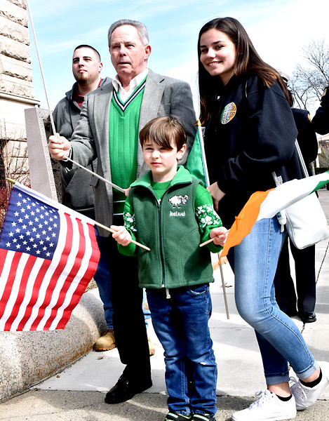 Rasing the Irish Flag is Jack Shanahan Irish Person of the Year, with his grandchildren Evan Shanahan 5 and Cate Shanahan 16 all from Lowell. SUN/ David H. Brow