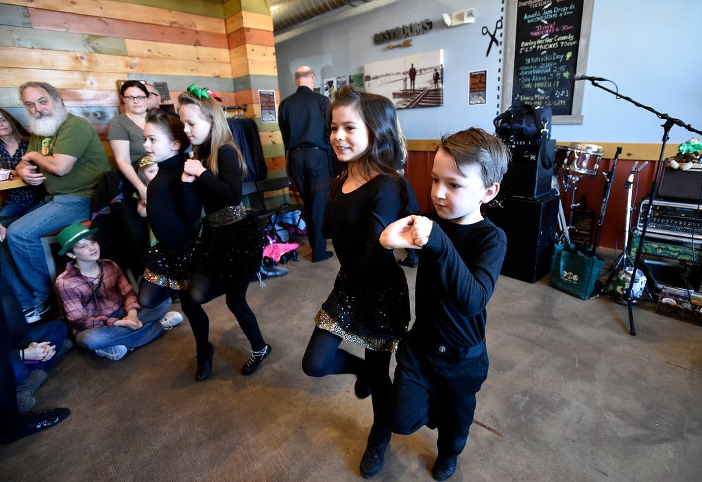 . LONGMONT, CO - MARCH 17, 2019: Moriarty Moffatt School of Dance performers Westin Ruehlen, 7, and Olivia, 9, dance together during a St. Patrick\'s Day celebration on Sunday at 300 Suns Brewing in Longmont. For more photos of the event go to dailycamera.com (Photo by Jeremy Papasso/Staff Photographer)