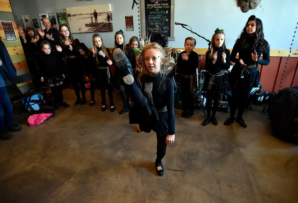 . LONGMONT, CO - MARCH 17, 2019: Moriarty Moffatt School of Dance performer Nuala Dougherty dances during a St. Patrick\'s Day celebration on Sunday at 300 Suns Brewing in Longmont. For more photos of the event go to dailycamera.com (Photo by Jeremy Papasso/Staff Photographer)