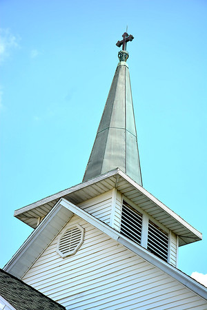 The original steeple was lowered along with the bell tower due to structure problems in 1963. Charles Mills photo