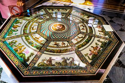 The design on this table in the Hermitage is a MOSAIC! It has unreal detail and pieces almost too small to see individually.