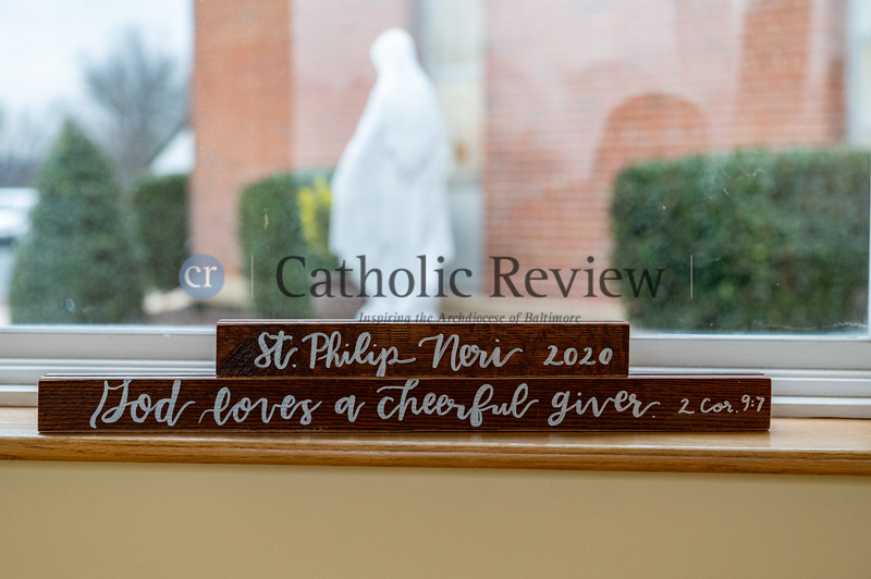Slats from the original sanctuary at St. Philip Neri Church in Linthicum Heights were cut into sections and were added with scripture as part of fund raising efforts for the parish's $1.5 million renovation. (Kevin J. Parks/CR Staff)