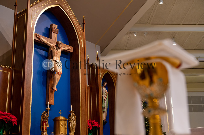 The original crucifix at St. Philip Neri Church in Linthicum Heights was painted by an artist to be more life-like and retrofitted for the new sanctuary as part of the parish's $1.5 million renovation. (Kevin J. Parks/CR Staff)