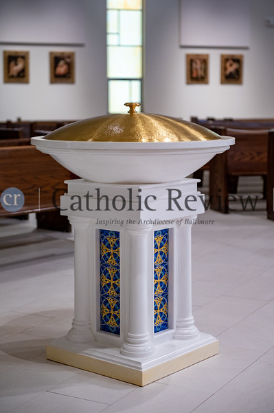 The new baptismal font at St. Philip Neri Church in Linthicum Heights was hand crafted from wood by artisans in Lima, Peru, which was initiated through a relationship with missionaries from the region currently at the parish. (Kevin J. Parks/CR Staff)